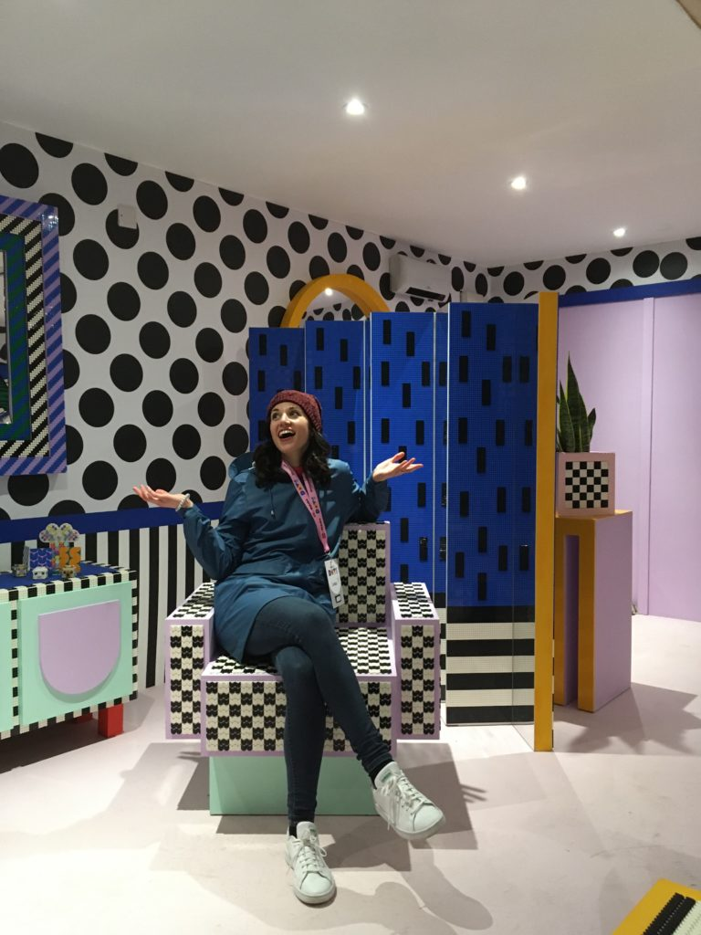 LEGO Set Designer Laura Perron sits in the inside the LEGO Dots house